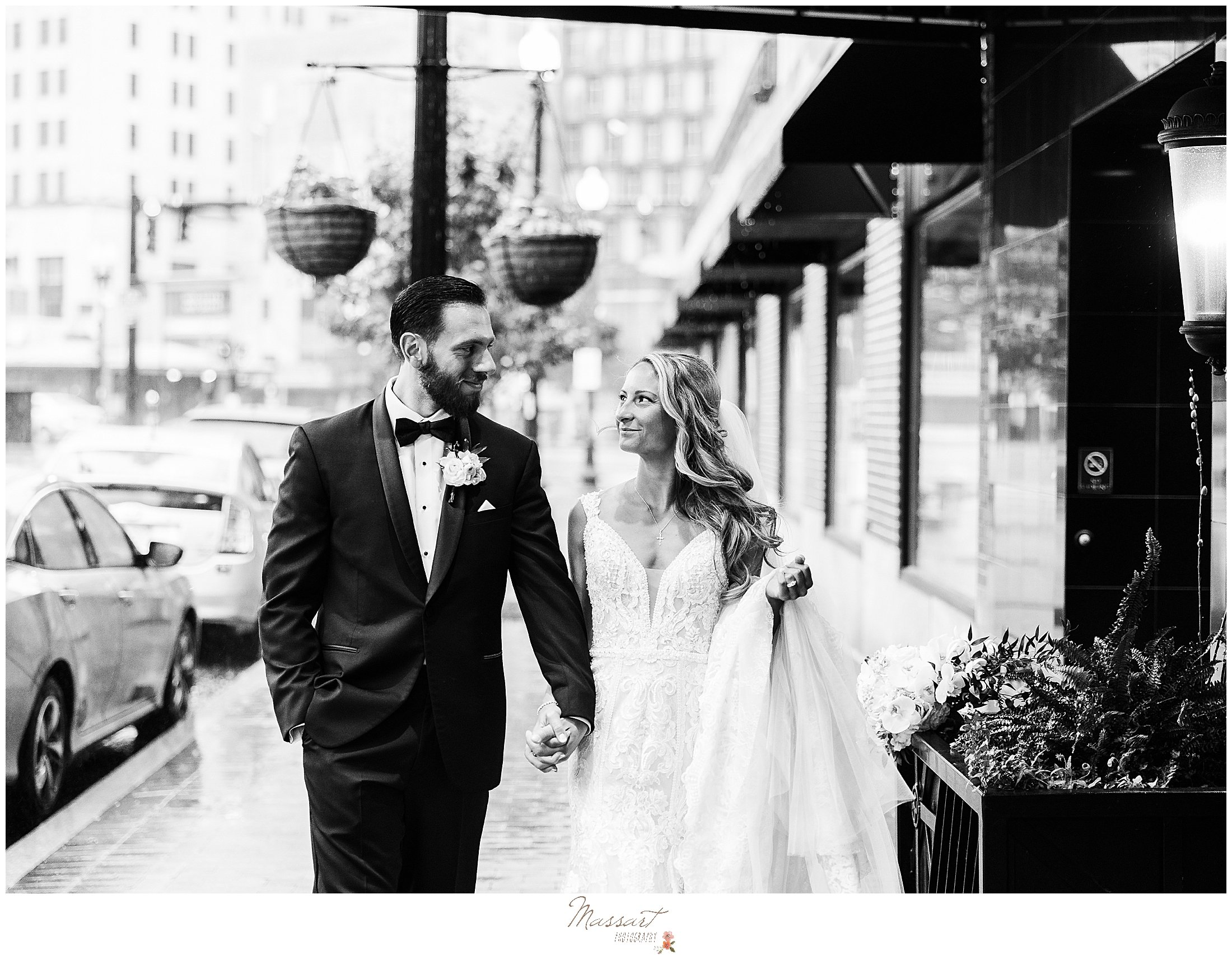 newlyweds hold hands walking down street in Providence RI