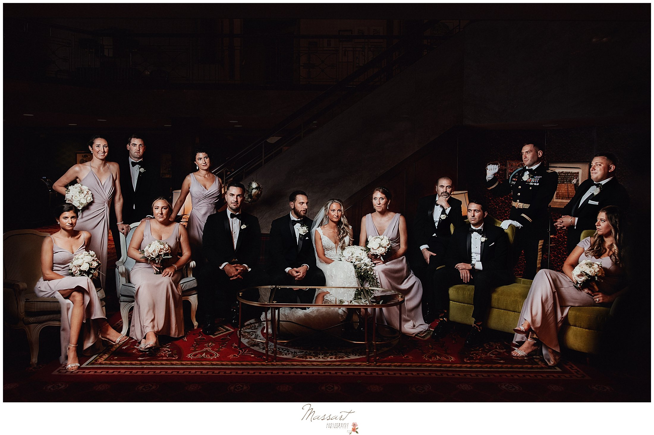 bridal party sits on couches at The Graduate hotel