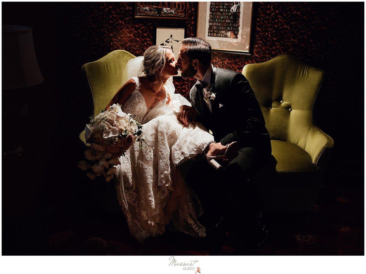 The Graduate Hotel wedding portraits on green sofas