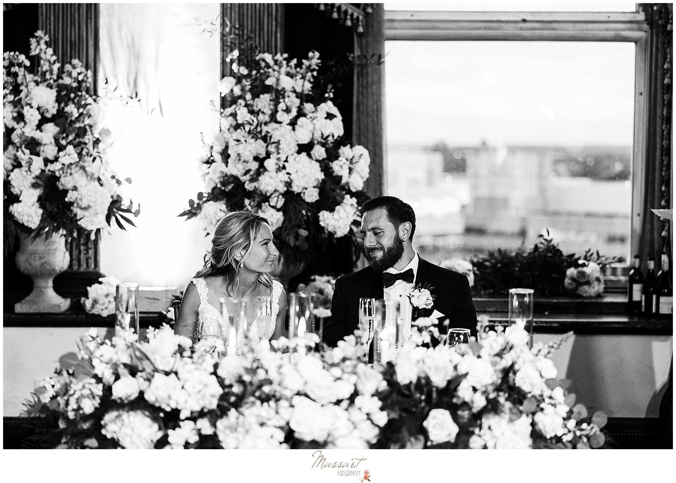 newlyweds sit at sweetheart table during Providence RI wedding reception