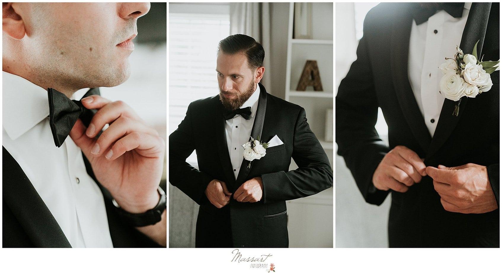 groom adjusts classic tux before Rhode Island wedding