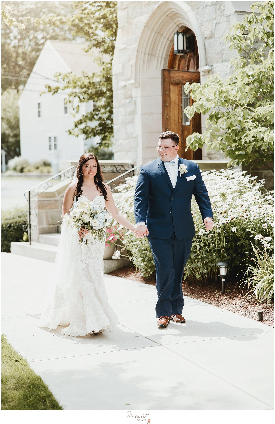 Massart Photographers take photo of couple after RI wedding ceremony