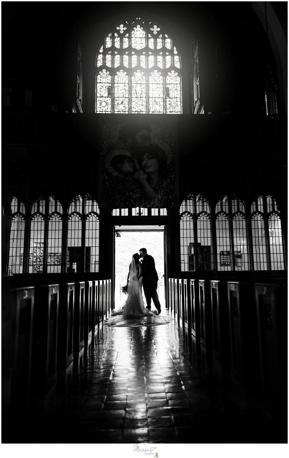 Dramatic church wedding portrait by RI photographers