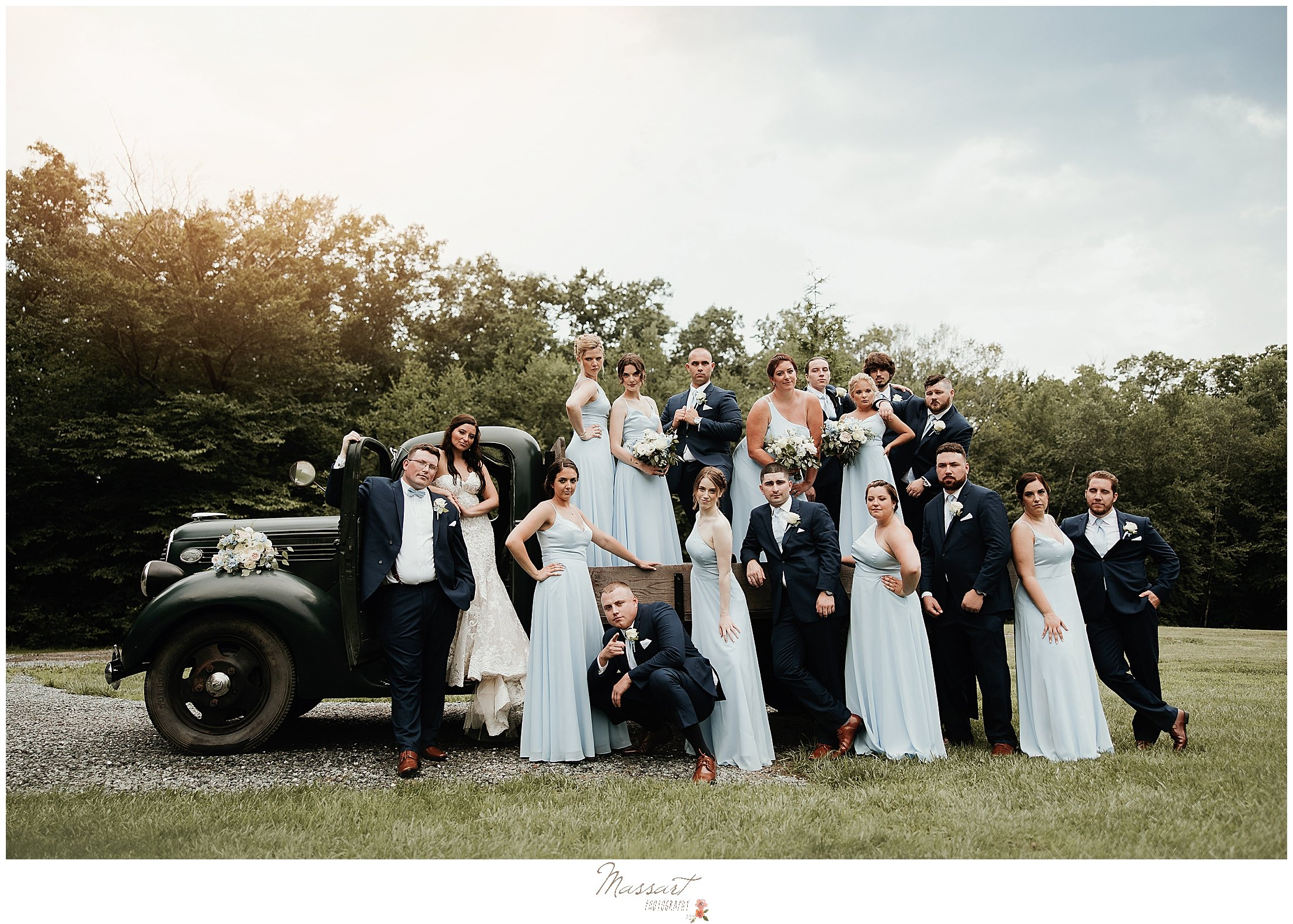 Bridal party poses on vintage truck at Five Bridge Inn for Massart Photographers from RI